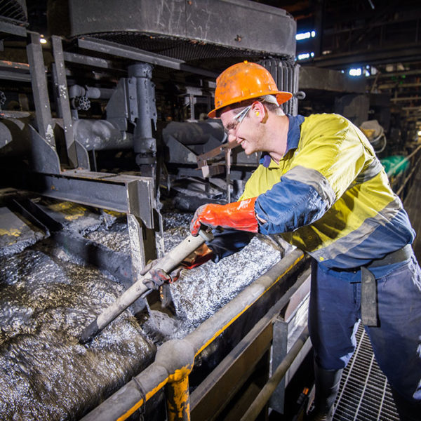 Mitchell Davidson, Processing Metallurgist, Zinc Processing at Glencore's Mount Isa Mines. Mitchell samples pulp during the lead floatation process at the Zinc Lead Concentrator. The photographer is Rob Parsons of Through The Looking Glass Studio. The Image Orientation is Landscape.