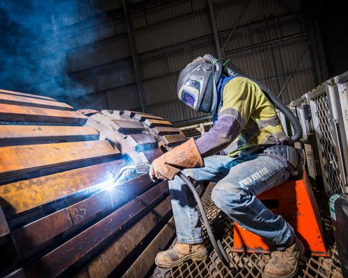 Nathan Brown, Boilermaker welding a loader bucket, Southern Cross Workshop. George Fisher Mine.